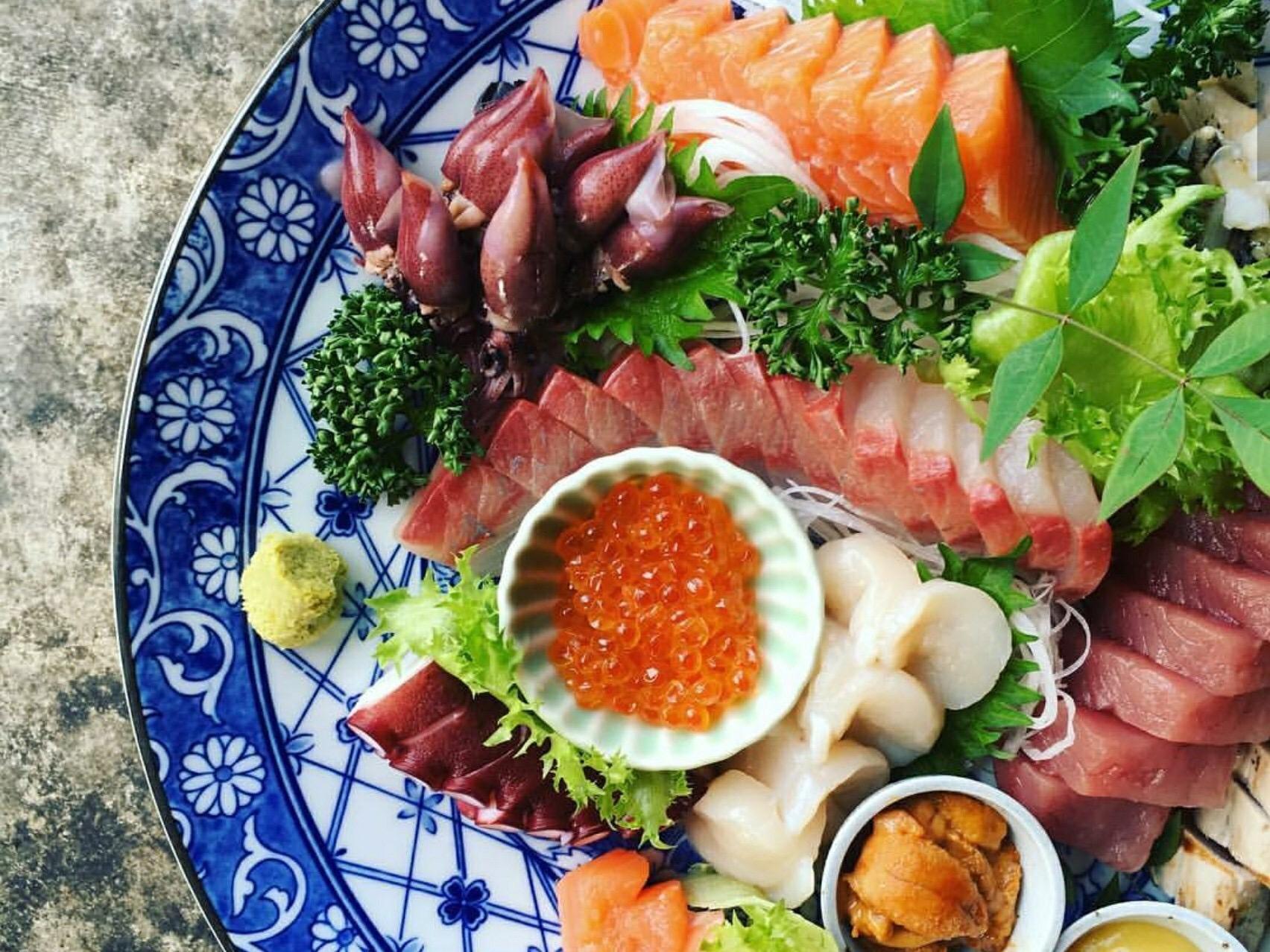 Taking out Sashimi mix