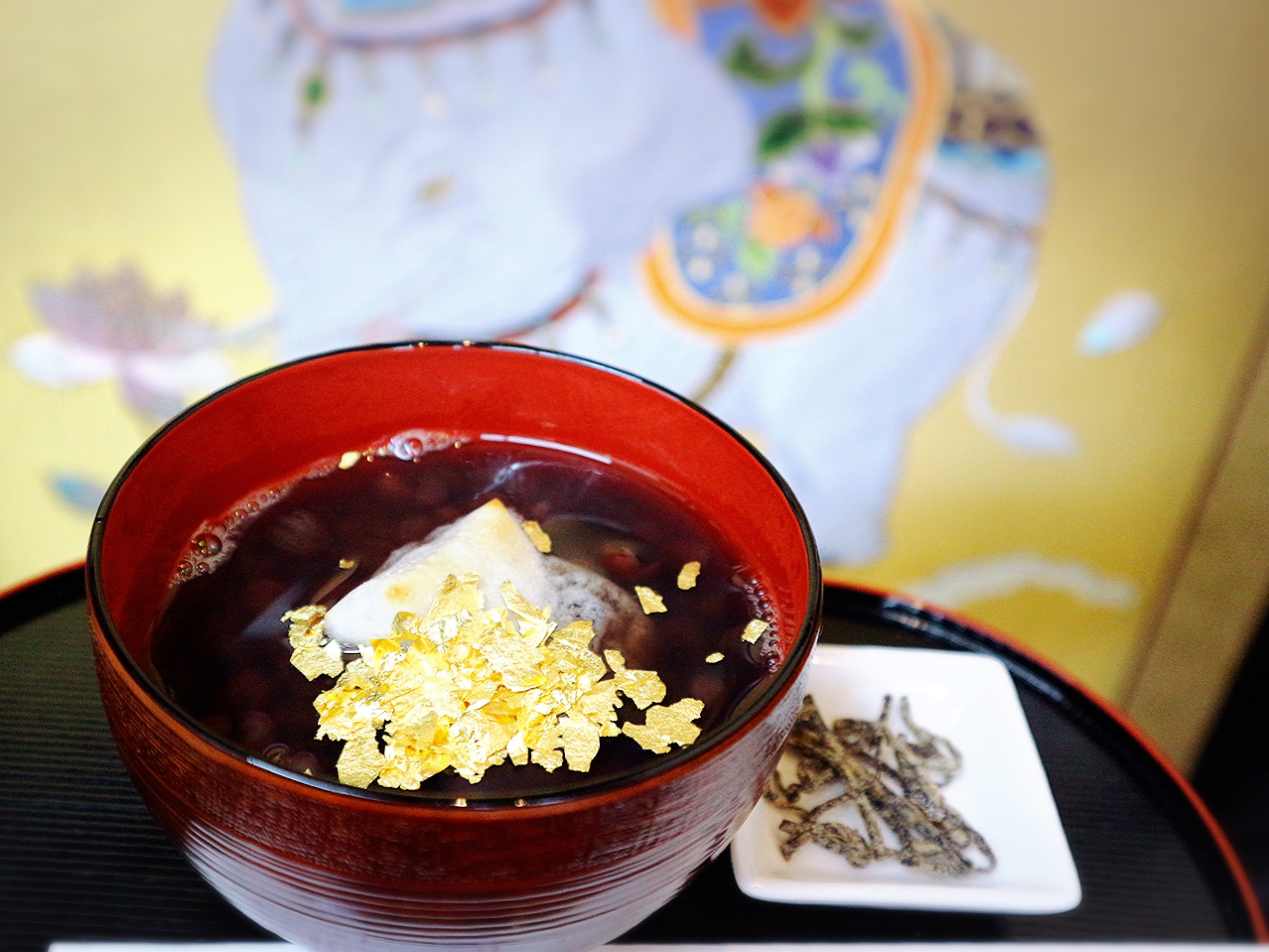Red Azuki bean soup with small Rokujo rice cakes and golden leaves
